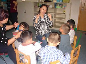 At the Amity Children's Development Centre, Nanjing. Teacher and Classroom Assistant working with pre-school children with autism.